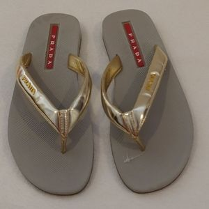 Prada metallic gold flip flops, new
